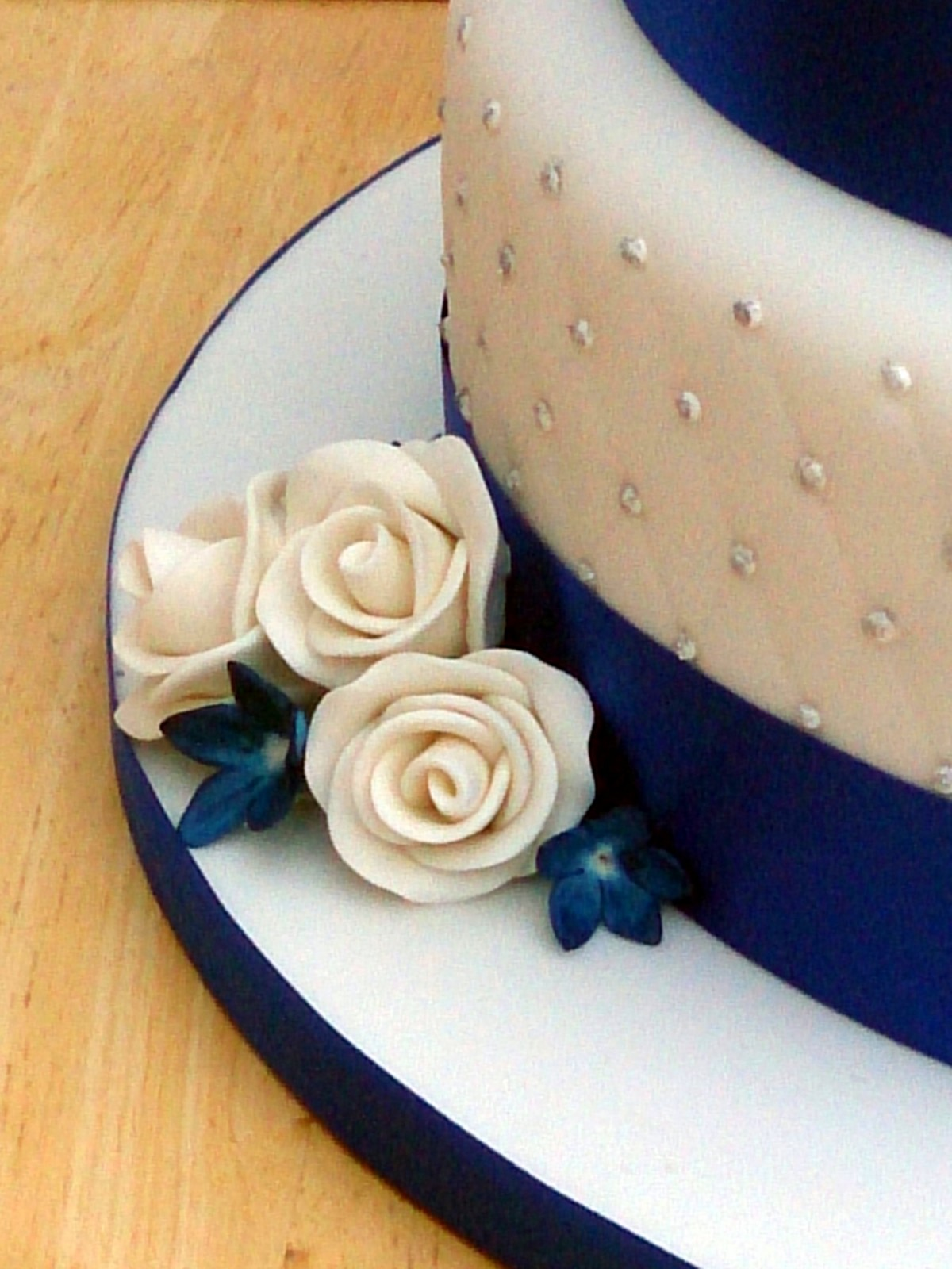3 Tier Round Stacked Wedding Cake With Sapphire Blue And